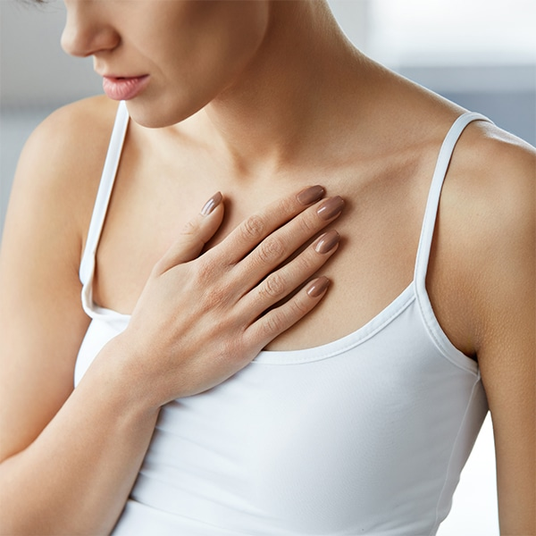 Woman with Hand on Heart for Vascular Diagnosis. Vascular Diagnosis and Treatment in Seattle at BoxBar Vascular