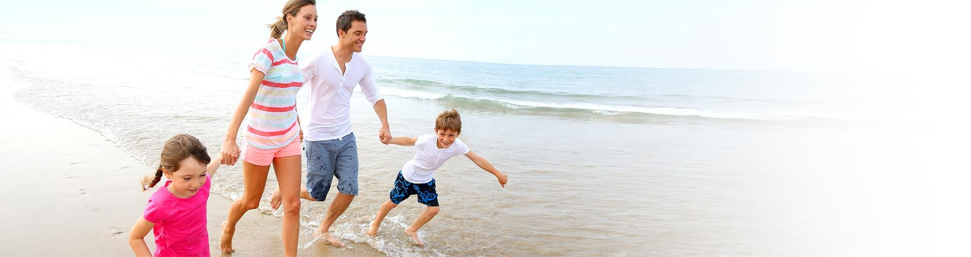 family running on the beach | DVT Diagnosis in Seattle